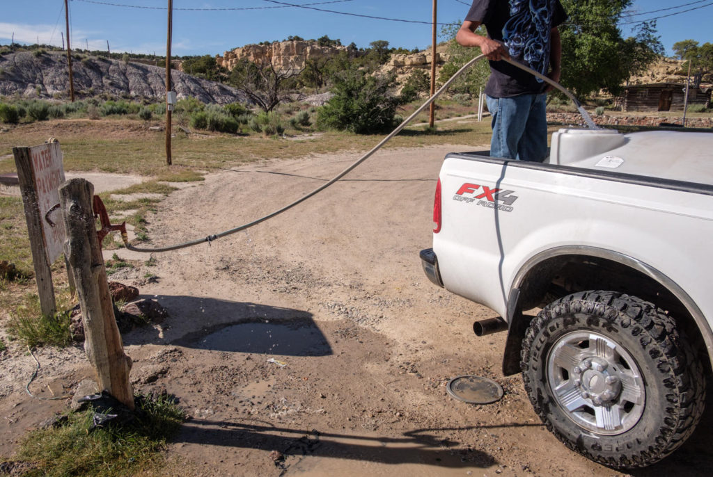 '[The mission is] one of the primary water sources for people in the community. There are people that do not have running water, and do not have electricity, and you know what, it's perfectly fine, they're very happy, we could learn a lot from that. But we have one of the purest aquifers in New Mexico.<br /><br />People come here from all around to get water. And they pay for it, it's on an honor system, they get their water and then they put their money in the little slot in the house over there.  I never double check to make sure everybody pays, I have people that get paid at the beginning of the month so they'll put money in there for the whole month. <br /><br />I would rather people came and got water and left and not worry about paying if they can't pay, I'd rather they have water.'<br /><br />- James, <a href='https://www.lcmmission.org/'>Lybrook Community Ministries</a>