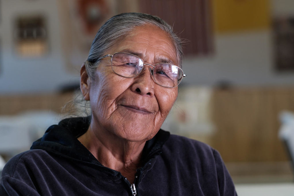 "'They say that was our land, but not anymore. I don't think we have land anymore. It's all theirs. [The companies] can do whatever they want to it and just throw a whole bunch of money to people.""<br /><br />- Sue, Community Elder"