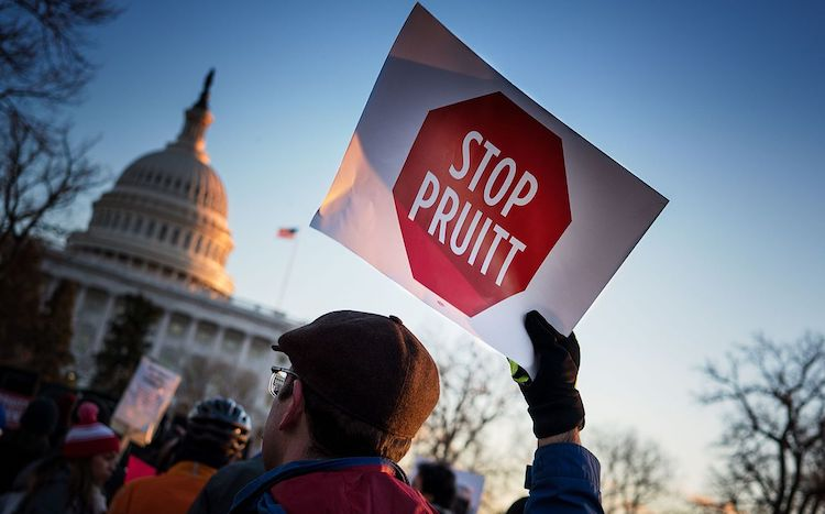 Protester with 'Stop Pruitt' sign